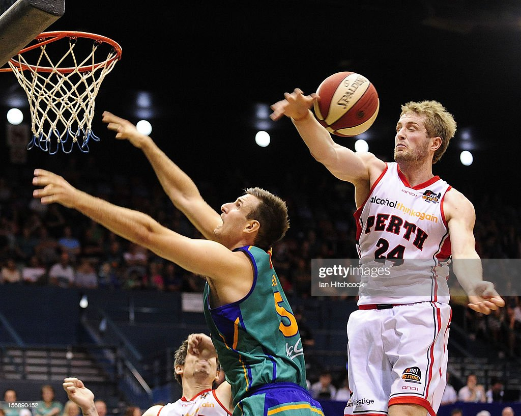 Jesse Wagstaff of the Wildcats contests the ball with Ben Allen of the Crocodiles during the round eight NBL match between the Townsville Crocodiles and the Perth Wildcats at Townsville Entertainment Centre on November 24, 2012 in Townsville, Australia.