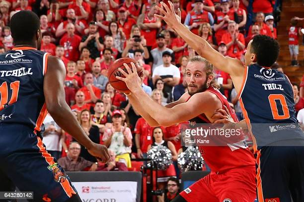 Jesse Wagstaff of the Wildcats controls the ball against Travis Trice of the Taipans during the game two NBL Semi Final match between the Perth...