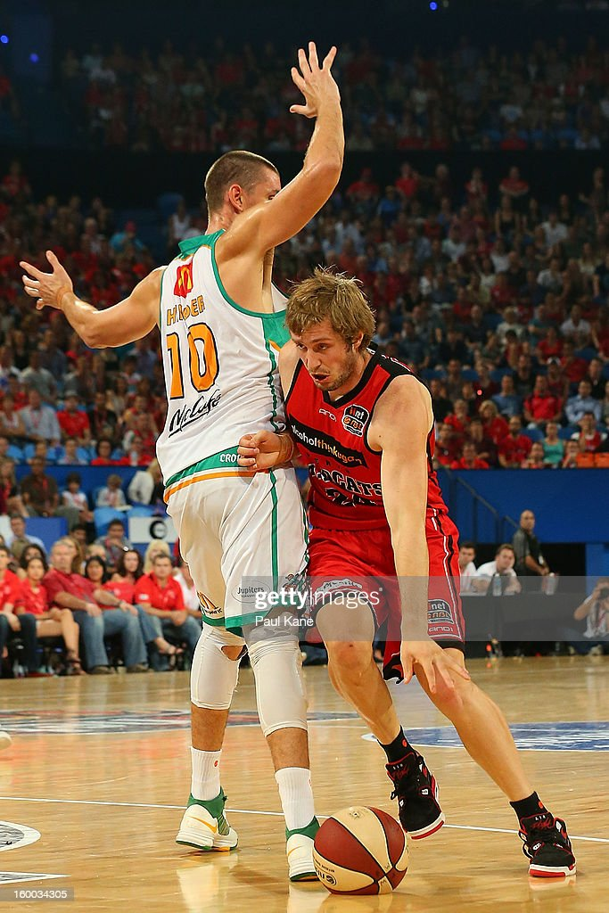 Jesse Wagstaff of the Wildcats dribbles past Russell Hinder during the round 16 NBL match between the Perth Wildcats and the Townsville Crocodiles at Perth Arena on January 25, 2013 in Perth, Australia.