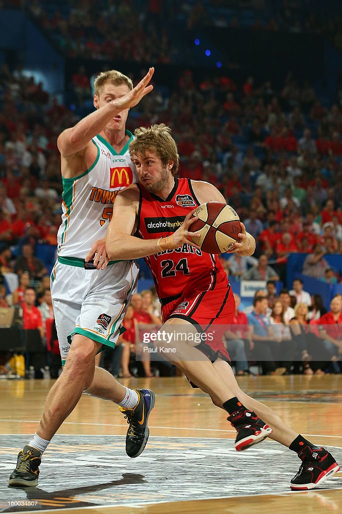 Jesse Wagstaff of the Wildcats drives to the basket against Luke Nevill of the Crocodiles during the round 16 NBL match between the Perth Wildcats and the Townsville Crocodiles at Perth Arena on January 25, 2013 in Perth, Australia.