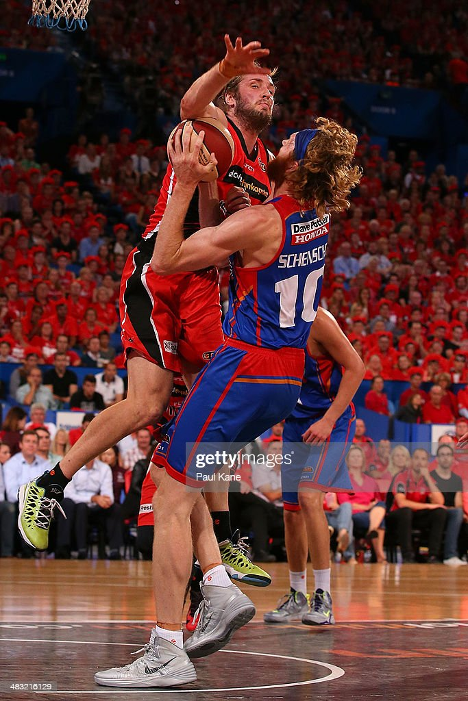 Jesse Wagstaff of the Wildcats fouls Luke Schenscher of the 36ers during game one of the NBL Grand Final series between the Perth Wildcats and the Adelaide 36ers at Perth Arena on April 7, 2014 in Perth, Australia.