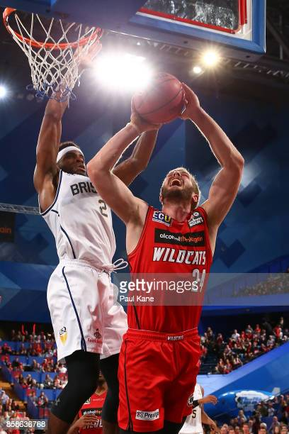 Jesse Wagstaff of the Wildcats gets fouled by Perrin Buford of the Bullets during the round one NBL match between the Perth Wildcats and the Brisbane...