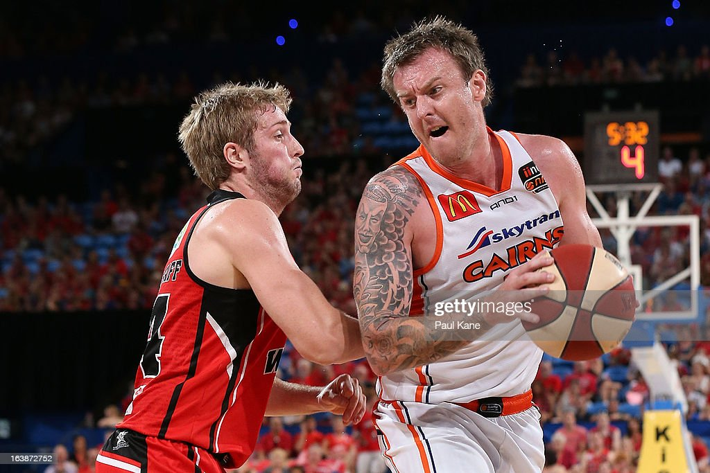 Jesse Wagstaff of the Wildcats holds out Cameron Tragardh of the Taipans during the round 23 NBL match between the Perth Wildcats and the Cairns Taipans at Perth Arena on March 17, 2013 in Perth, Australia.