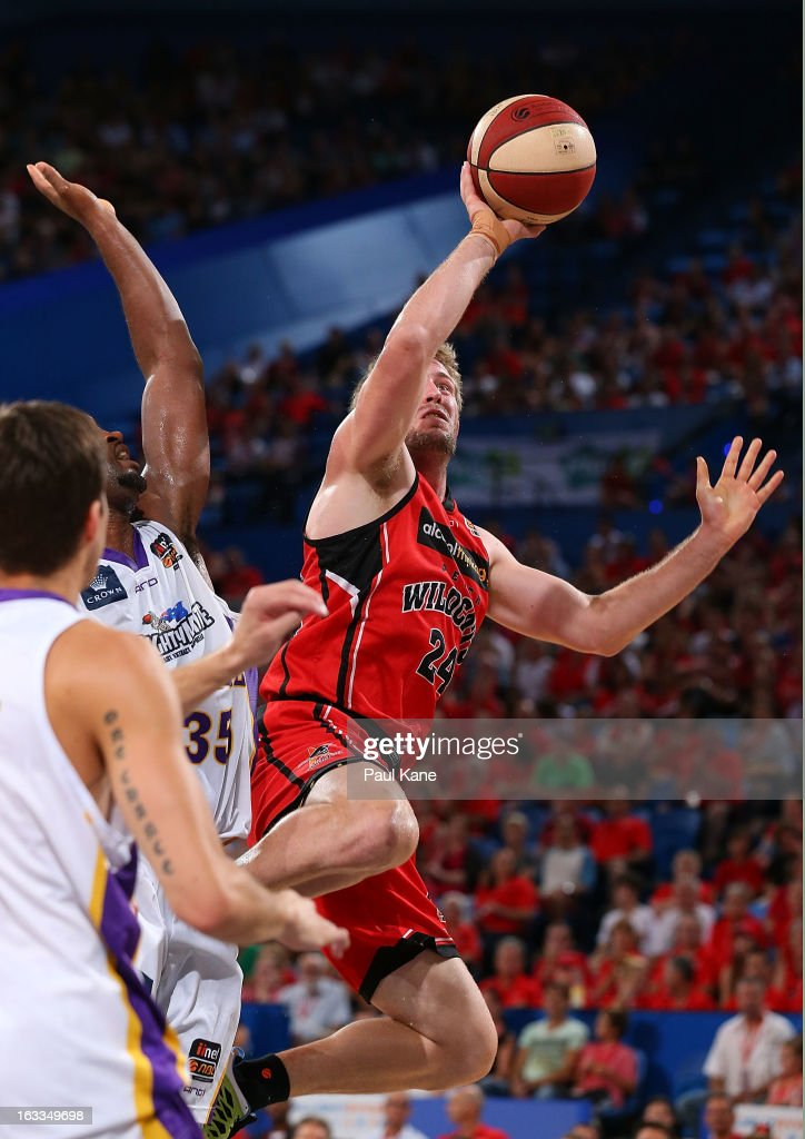 Jesse Wagstaff of the Wildcats lays up against Darnell Lazare of the Kings during the round 22 NBL match between the Perth Wildcats and the Sydney Kings at Perth Arena on March 8, 2013 in Perth, Australia.