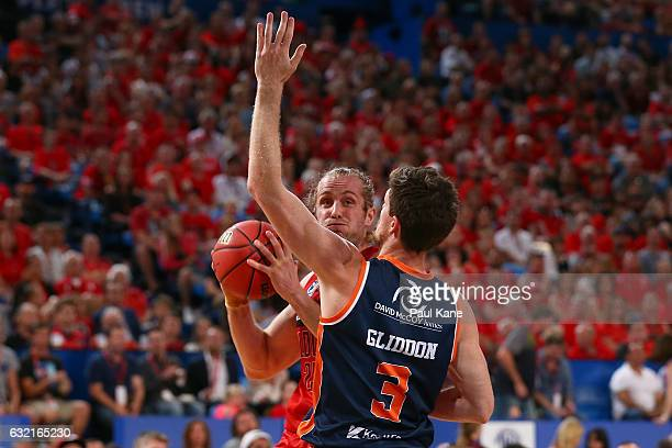 Jesse Wagstaff of the Wildcats looks to pass against Cameron Gliddon of the Taipans during the round 16 NBL match between the Perth Wildcats and the...