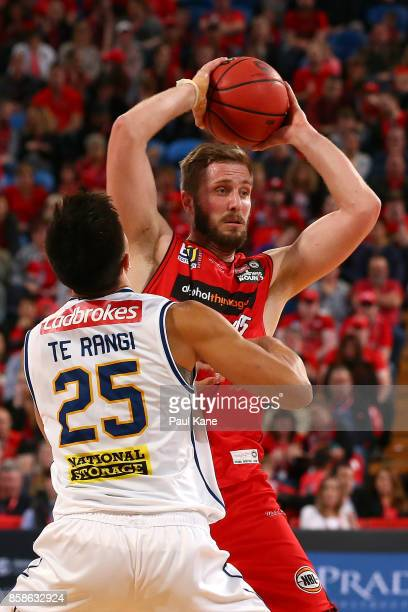 Jesse Wagstaff of the Wildcats looks to pass against Reuben TeRangi of the Bullets during the round one NBL match between the Perth Wildcats and the...