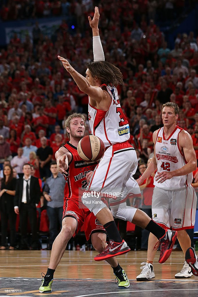 Jesse Wagstaff of the Wildcats passes the ball against Auryn MacMillan of the Hawks during game one of the NBL Semi Final Series between the Perth Wildcats and the Wollongong Hawks at Perth Arena on March 28, 2013 in Perth, Australia.