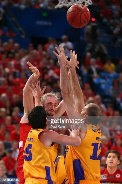 Jesse Wagstaff of the Wildcats passes the ball against Jason Cadee and Aleks Maric of the Kings of the King during the round 19 NBL match between the...