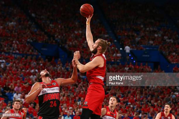 Jesse Wagstaff of the Wildcats puts a shot up against Cody Ellis of the Hawks during game one of the NBL Grand Final series between the Perth...