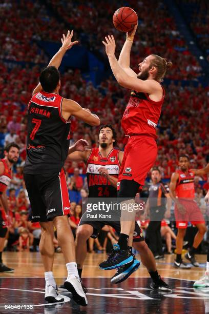Jesse Wagstaff of the Wildcats puts a shot up against Oscar Forman of the Hawks during game one of the NBL Grand Final series between the Perth...