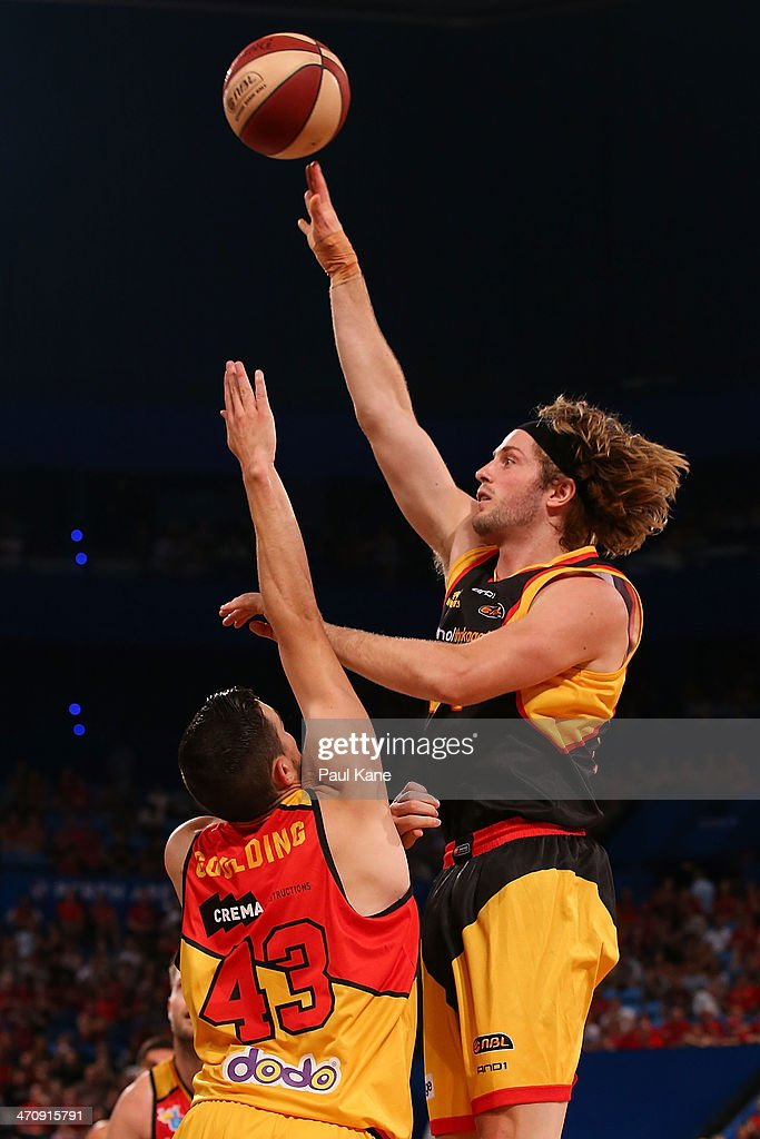 Jesse Wagstaff of the Wildcats shoots against Chris Goulding of the Tigers during the round 19 NBL match between the Perth Wildcats and the Melbourne Tigers at Perth Arena on February 21, 2014 in Perth, Australia.