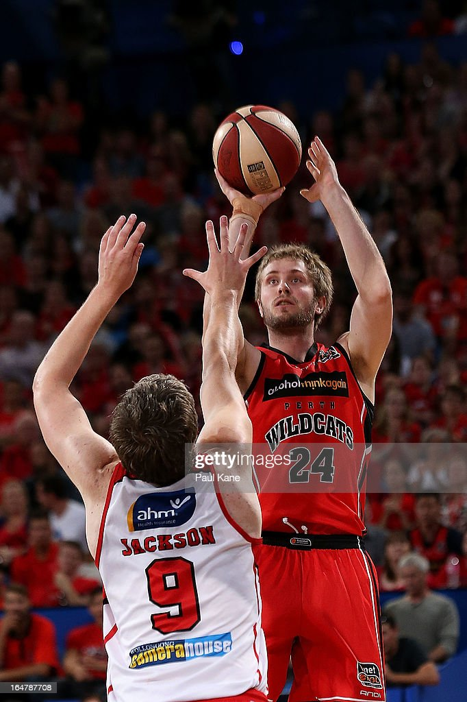 Jesse Wagstaff of the Wildcats shoots against Daniel Jackson of the Hawks during game one of the NBL Semi Final Series between the Perth Wildcats and the Wollongong Hawks at Perth Arena on March 28, 2013 in Perth, Australia.
