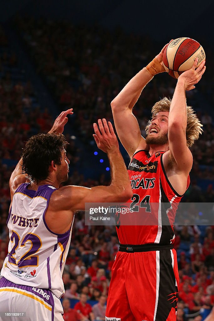 Jesse Wagstaff of the Wildcats shoots against Kevin White of the Kings during the round two NBL match between the Perth Wildcats and the Sydney Kings at Perth Arena in October 18, 2013 in Perth, Australia.