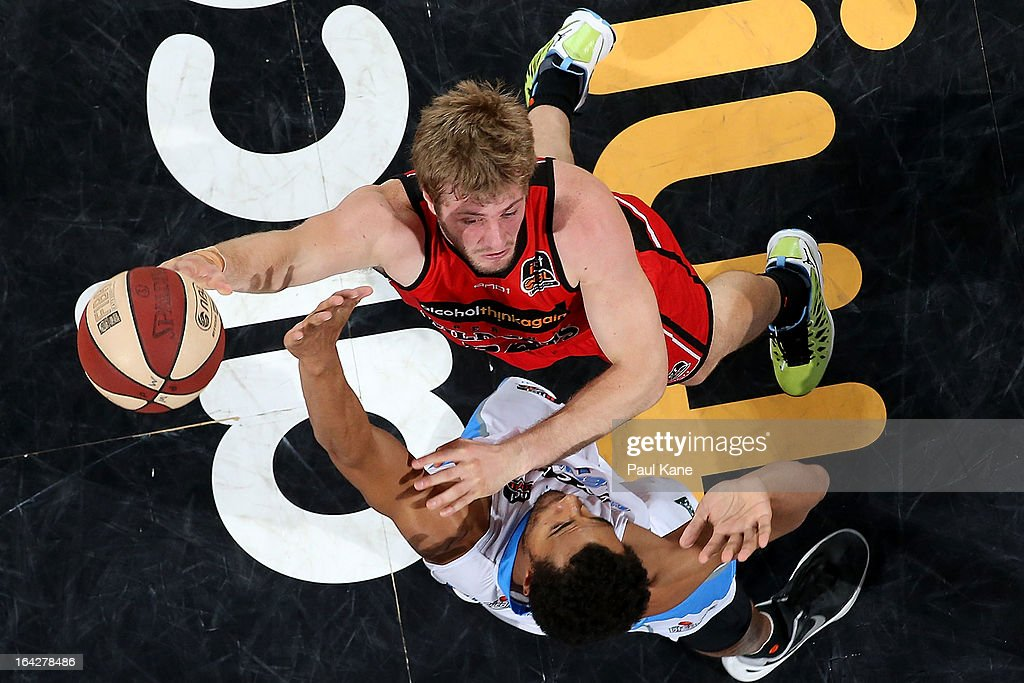 Jesse Wagstaff of the Wildcats shoots against Mika Vukona of the Breakers during the round 24 NBL match between the Perth Wildcats and the New Zealand Breakers at Perth Arena on March 22, 2013 in Perth, Australia.