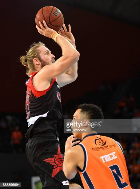 Jesse Wagstaff of the Wildcats takes a shot over Travis Trice of the Taipans during the round 18 NBL match between the Cairns Taipans and the Perth...