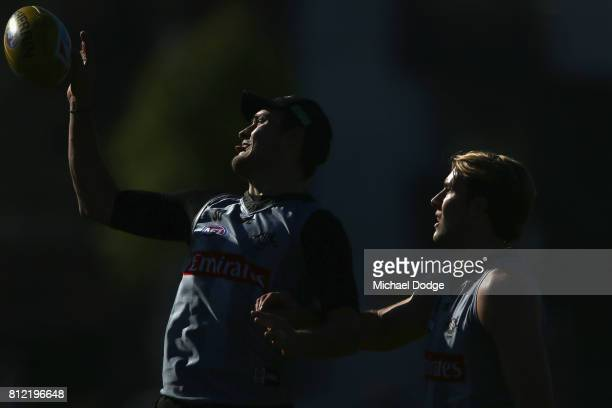 Jesse White and Darcy Moore compete for the ball during a Collingwood Magpies AFL training at the Holden Centre on July 11 2017 in Melbourne Australia