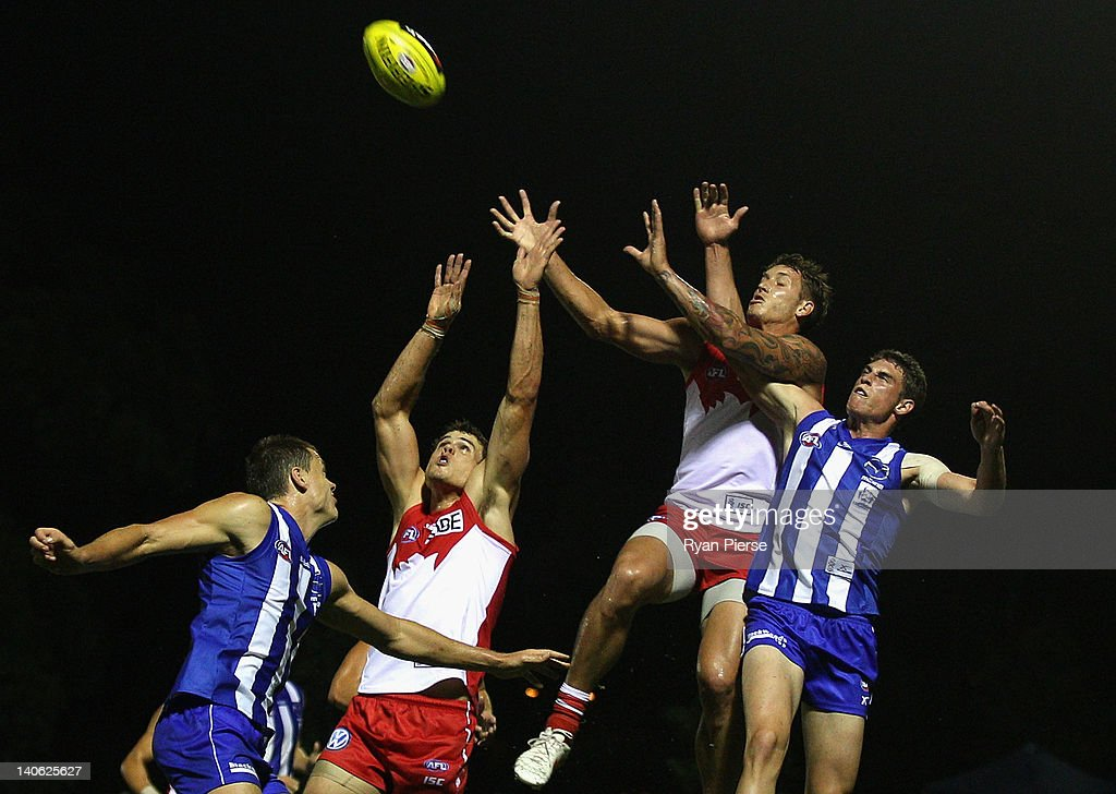 Jesse White and Mike Pyke of the Swans competes for the ball against Cameron Delaney of the Kangaroos during the round two NAB Cup AFL match between the Sydney Swans and the North Melbourne Kangaroos at Bruce Purser Oval on March 3, 2012 in Sydney, Australia.