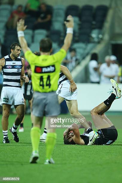 Jesse White of the Magpies reacts on the siren after losing during the round one AFL NAB Cup match between the Geelong Cats and the Collingwood...
