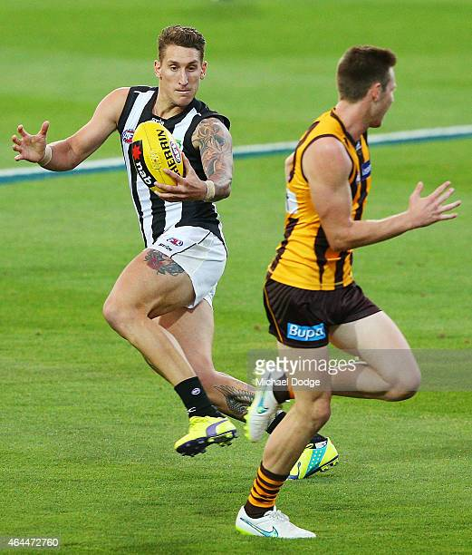 Jesse White of the Magpies runs with the ball during the NAB Challenge AFL match between Hawthorn Hawks and the Collingwood Magpies at Aurora Stadium...