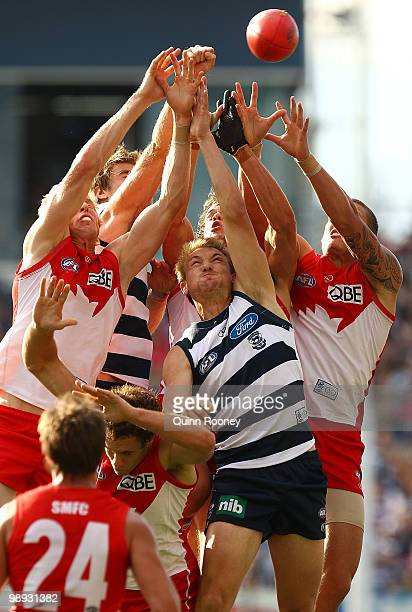 Jesse White of the Swans attempts to mark over Darren Milburn of the Cats during the round seven AFL match between the Geelong Cats and the Sydney...