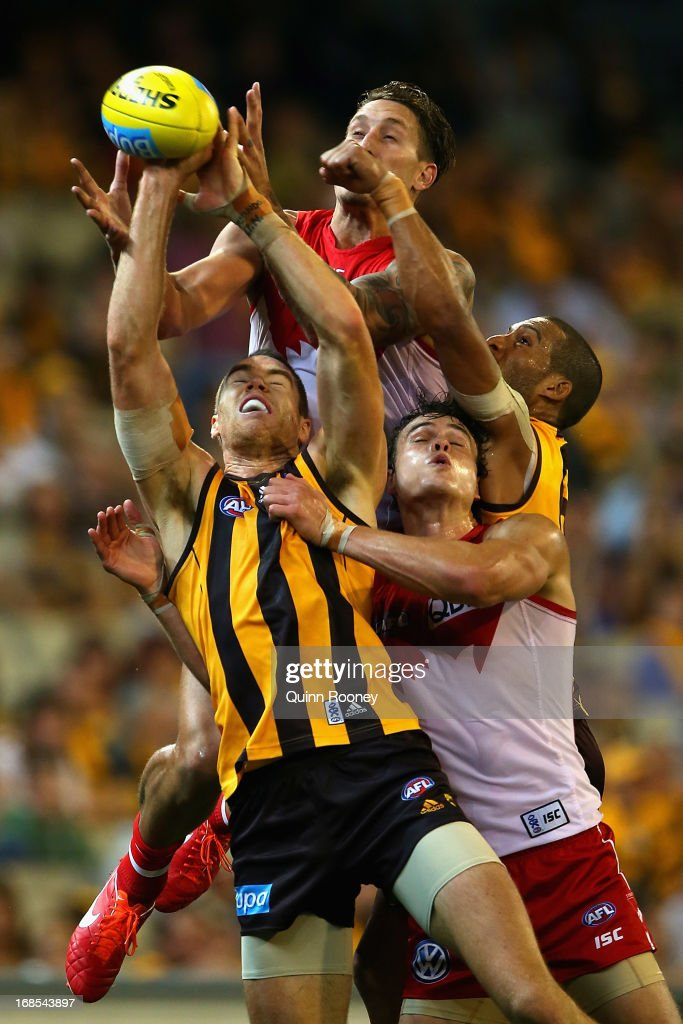Jesse White of the Swans attempts to mark over the top of Max Bailey of the Hawks during the round seven AFL match between the Hawthorn Hawks and the Sydney Swans at Melbourne Cricket Ground on May 11, 2013 in Melbourne, Australia.
