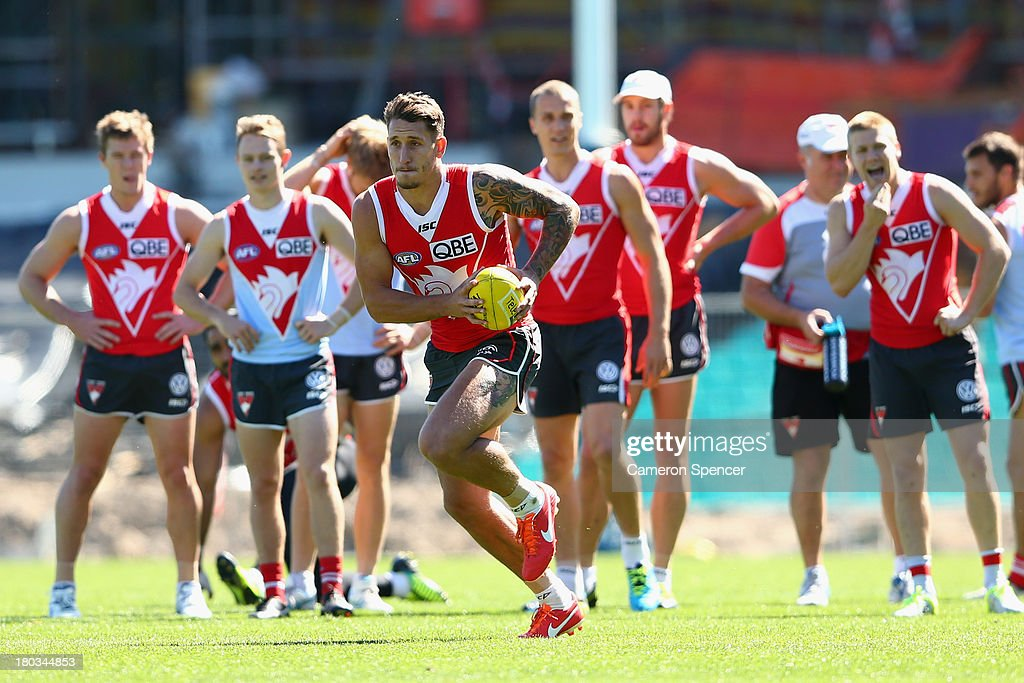 Jesse White of the Swans runs the ball during a Sydney Swans AFL training session at Sydney Cricket Ground on September 12, 2013 in Sydney, Australia.
