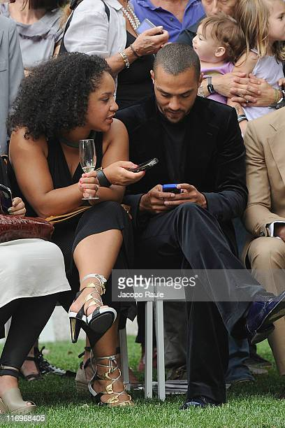 Jesse Williams and Aryn DrakeLee attend the Roberto Cavalli fashion show as part of Milan Fashion Week Menswear Spring/Summer 2012 on June 18 2011 in...
