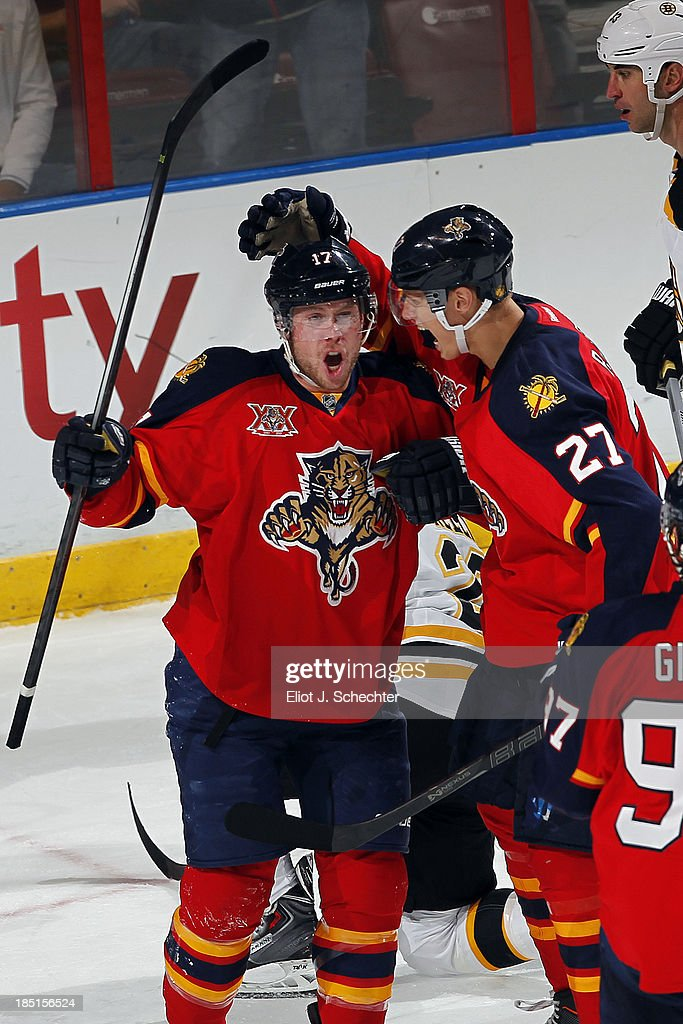 Jesse Winchester #17 of the Florida Panthers celebrates his first NHL goal with teammate <a gi-track='captionPersonalityLinkClicked' href=/galleries/search?phrase=Nick+Bjugstad&family=editorial&specificpeople=7029343 ng-click='$event.stopPropagation()'>Nick Bjugstad</a> #27 against the Boston Bruins at the BB&T Center on October 17, 2013 in Sunrise, Florida.