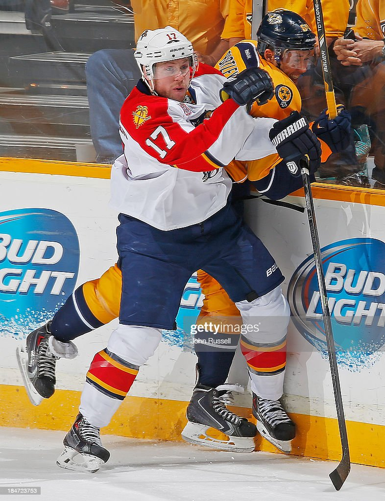 Jesse Winchester #17 of the Florida Panthers checks Victor Bartley #64 of the Nashville Predators at Bridgestone Arena on October 15, 2013 in Nashville, Tennessee.