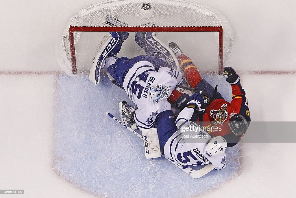 Jesse Winchester #17 of the Florida Panthers collides with <a gi-track='captionPersonalityLinkClicked' href=/galleries/search?phrase=Jake+Gardiner&family=editorial&specificpeople=4884939 ng-click='$event.stopPropagation()'>Jake Gardiner</a> #51 and goaltender <a gi-track='captionPersonalityLinkClicked' href=/galleries/search?phrase=Jonathan+Bernier&family=editorial&specificpeople=540491 ng-click='$event.stopPropagation()'>Jonathan Bernier</a> #45 of the Toronto Maple Leafs at the BB&T Center on February 4, 2014 in Sunrise, Florida. The Panthers defeated the Maple Leafs 4-1.