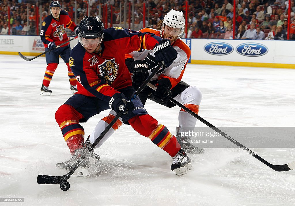 Jesse Winchester #17 of the Florida Panthers crosses sticks with Sean Couturier #14 of the Philadelphia Flyers at the BB&T Center on April 8, 2014 in Sunrise, Florida.
