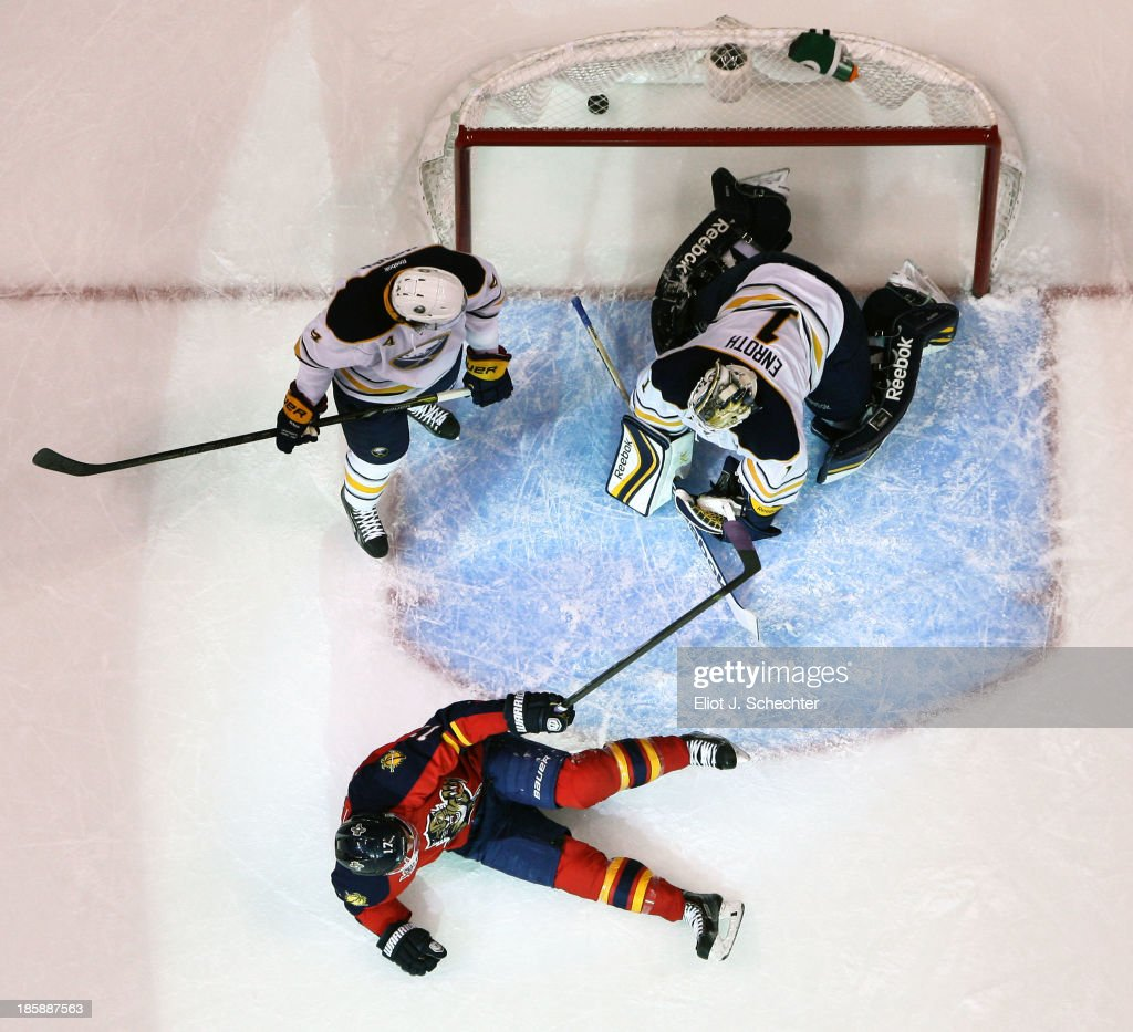 Jesse Winchester #17 of the Florida Panthers scores a goal against goaltender <a gi-track='captionPersonalityLinkClicked' href=/galleries/search?phrase=Jhonas+Enroth&family=editorial&specificpeople=570456 ng-click='$event.stopPropagation()'>Jhonas Enroth</a> #1 of the Buffalo Sabres at the BB&T Center on October 25, 2013 in Sunrise, Florida.