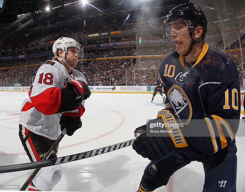 Jesse Winchester #18 of the Ottawa Senators moves in to hit <a gi-track='captionPersonalityLinkClicked' href=/galleries/search?phrase=Christian+Ehrhoff&family=editorial&specificpeople=214788 ng-click='$event.stopPropagation()'>Christian Ehrhoff</a> #10 of the Buffalo Sabres at the First Niagara Center on November 11, 2011 in Buffalo, New York. The Sabres defeated the Senators 5-1.