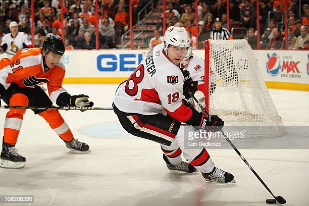 Jesse Winchester of the Ottawa Senators skates with the puck against James van Riemsdyk of the Philadelphia Flyers on January 20 2011 at the Wells...