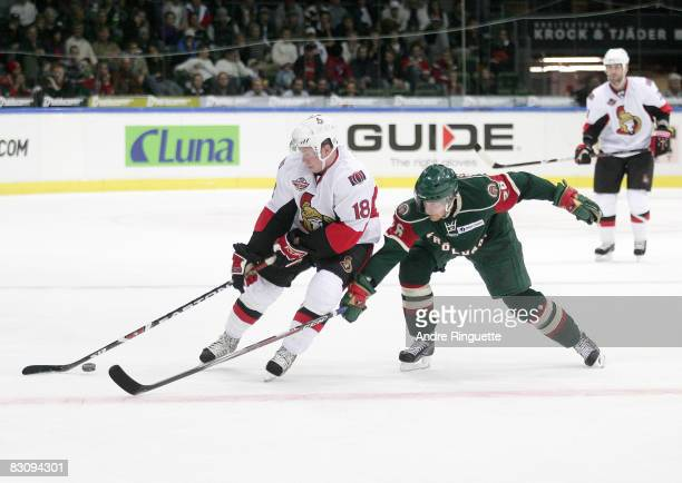 Jesse Winchester of the Ottawa Senators stickhandles the puck away from a stick check by Toni Soderholm of the Frolunda Indians at Scandinavium Arena...
