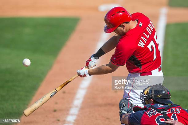 Jesse Winker of the Cincinnati Reds bats during a spring training game against the Cleveland Indians at Goodyear Ballpark on March 3 2015 in Goodyear...