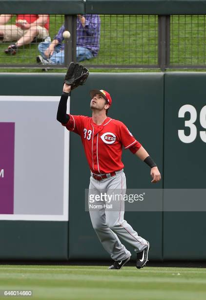 Jesse Winker of the Cincinnati Reds catches a fly ball during the second inning against the Arizona Diamondbacks at Salt River Fields at Talking...