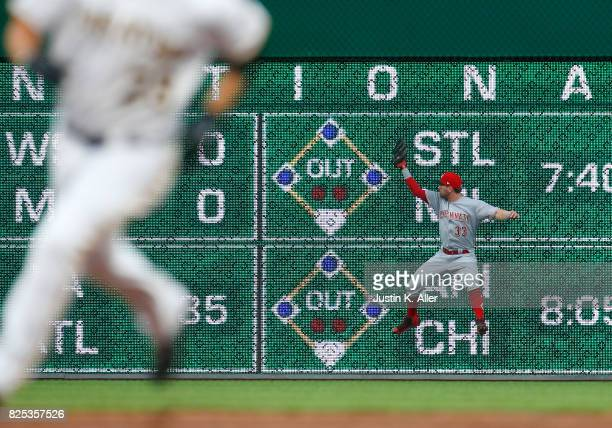 Jesse Winker of the Cincinnati Reds makes a catch in the first inning against the Pittsburgh Pirates at PNC Park on August 1 2017 in Pittsburgh...