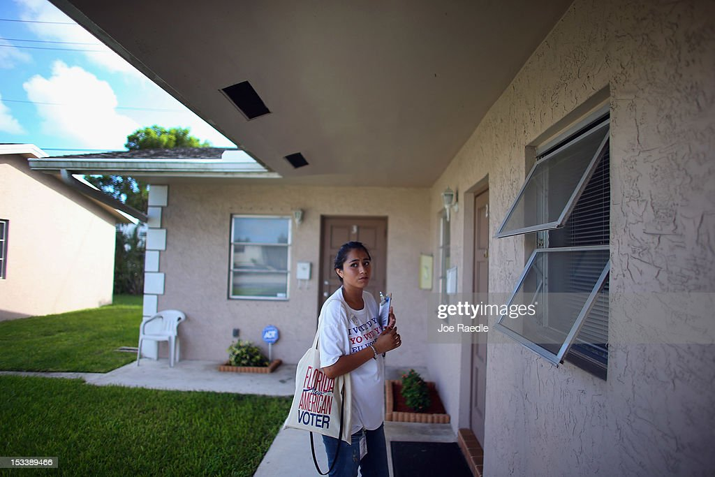 Jessenia Fernandez waits to see if anyone is home as she goes door to door in an apartment complex looking for people that have not registered to...