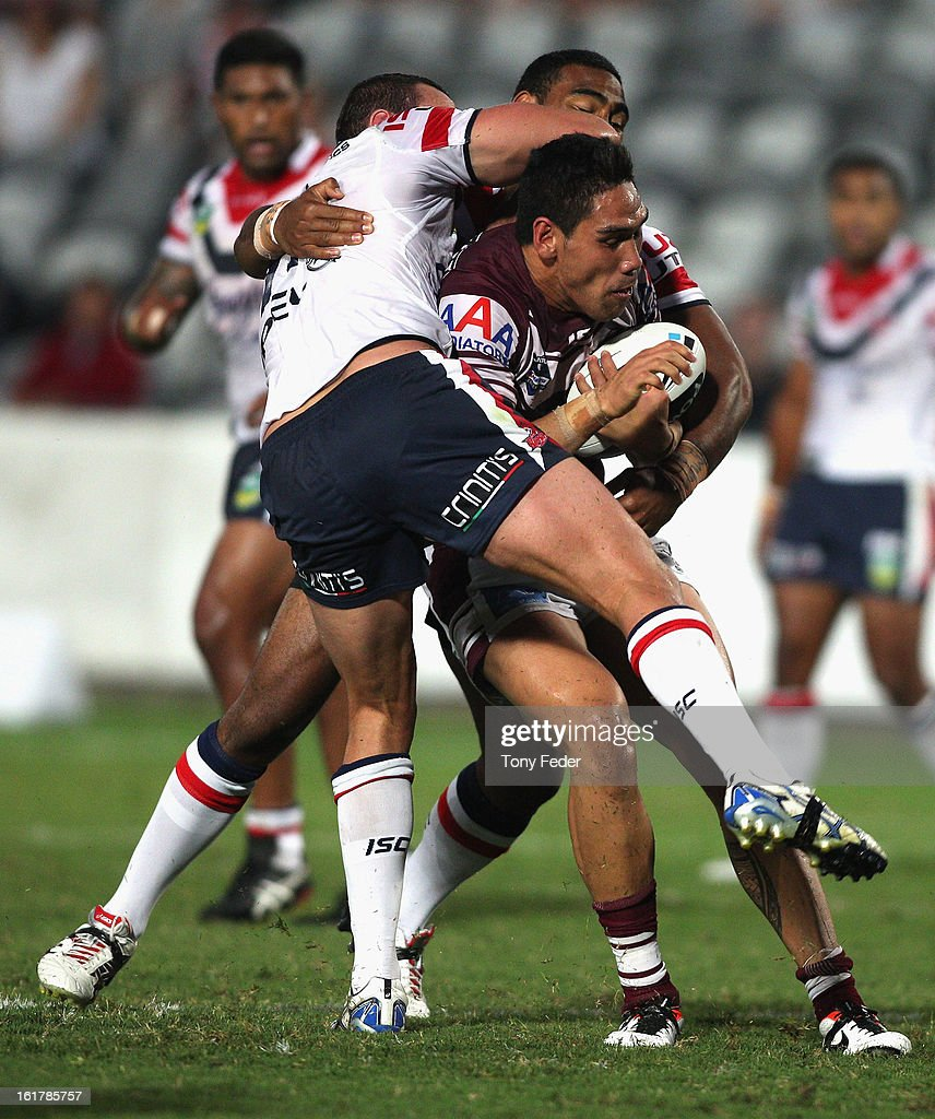 Jesse-Sene-Lefao of the Sea Eagles is tackled by the Roosters defence during the NRL trial match between the Manly Sea Eagles and the Sydney Roosters at Bluetongue Stadium on February 16, 2013 in Gosford, Australia.