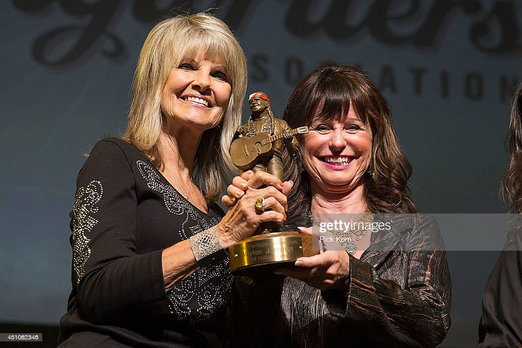 Jessi Colter (R) receives the Willie Nelson award from Connie Nelson (L) on behalf of the late Waylon Jennings during the 9th Annual Texas Heritage Songwriters' Hall of Fame Awards Show at ACL Live on June 22, 2014 in Austin, Texas.