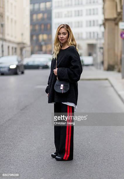 Jessi Quednau wearing a black HM knit sweater a black Zara pants with red stripes black Topshop boots Chloe bag on December 20 2016 in Berlin Germany
