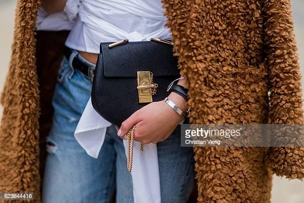 Jessi Quednau wearing white blouse Storets ripped denim jeans Levi0 a brown teddy coat Paisie via Asos a black Chloe bag on November 16 2016 in...