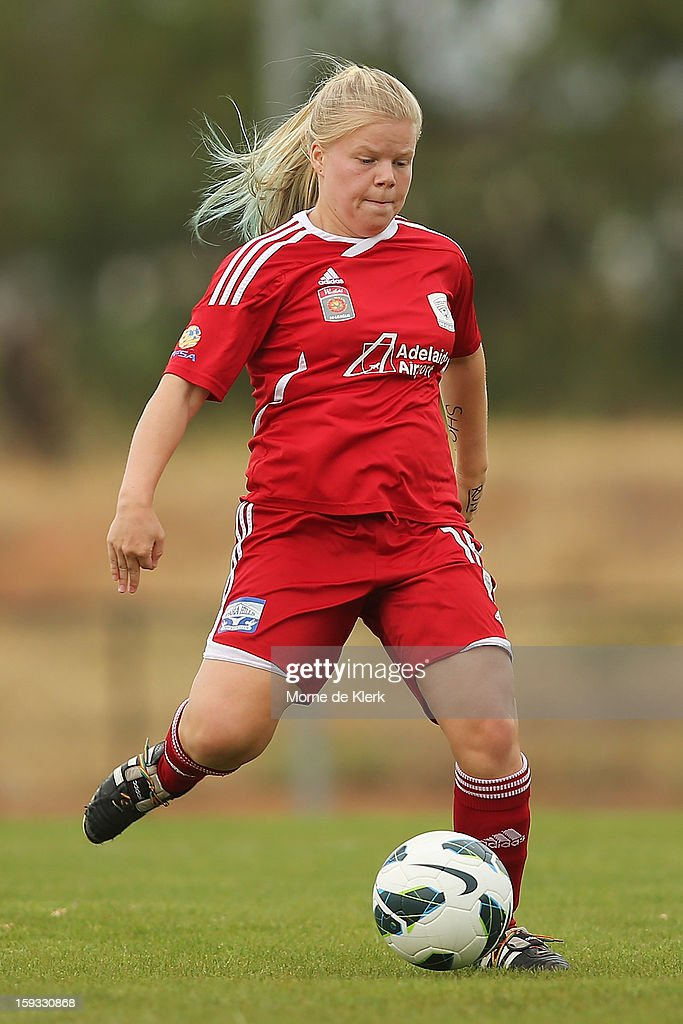 Jessic Waterhouse of Adelaide runs with the ball during the round 12 W-League match between Adelaide United and the Perth Glory at Burton Park on January 12, 2013 in Adelaide, Australia.