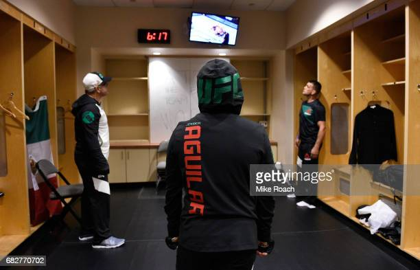 Jessica Aguilar watches the fights backstage during the UFC 211 event at the American Airlines Center on May 13 2017 in Dallas Texas
