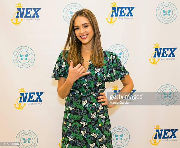 Jessica Alba flashes a Hawaiian shaka before a meet and greet hosted by the Honest Company at the Pearl Harbor NEX December 4 in Honolulu Hawaii