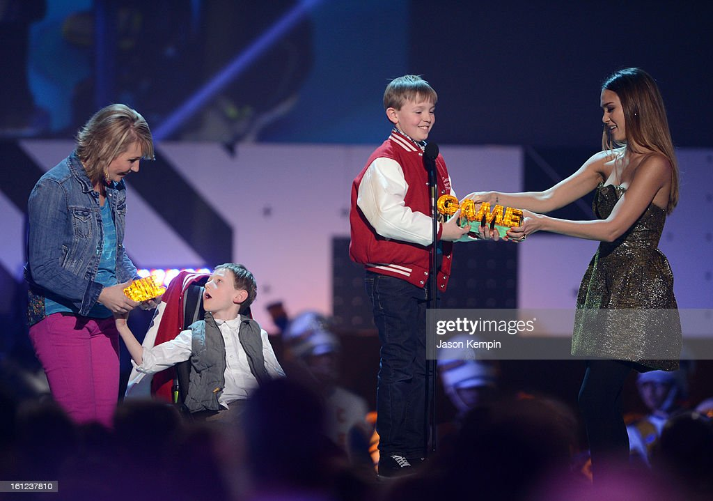 Jessica Alba gives the Game award to Connor Long onstage at the Third Annual Hall of Game Awards hosted by Cartoon Network at Barker Hangar on February 9, 2013 in Santa Monica, California. 23270_003_JK_0391.JPG