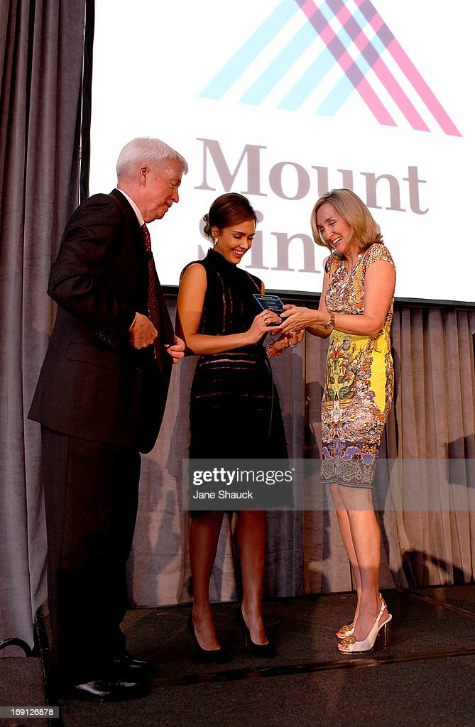 Jessica Alba receives award from Rhonda Sherwood, Founding Vice Chairman of Mt. Sinai Children's Environmental Health Center, and Dr. Philip J. Landrigan at the Champion For Children Award Ceremony Honoring Jessica Alba at Hyatt Regency Greenwich on May 20, 2013 in Greenwich, Connecticut.