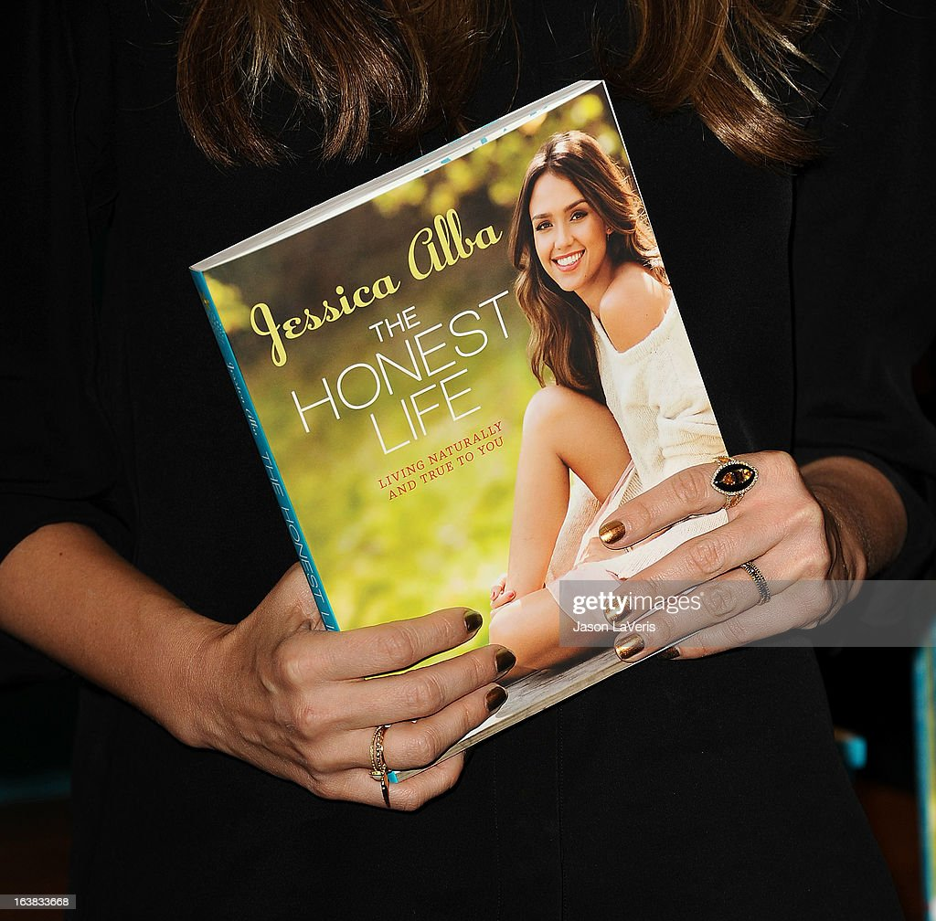 Jessica Alba (jewelry detail) signs copies of her new book 'The Honest Life' at Vroman's Bookstore on March 16, 2013 in Pasadena, California.