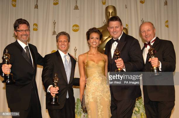 Jessica Alba with Christopher Boyes Michael Semanick Michael Hedges and Hammond Peek with their awards for Best Sound Mixing for King Kong